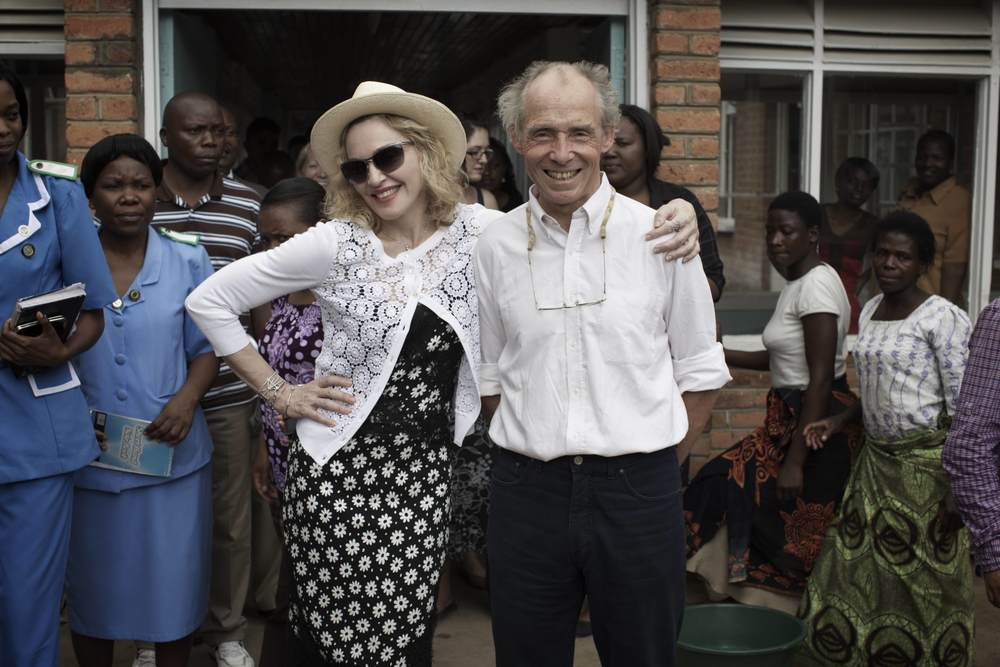 Madonna and Dr. Eric Borgstein, Chief of Pediatric Surgery at Queen Elizabeth Hospital. November 2014