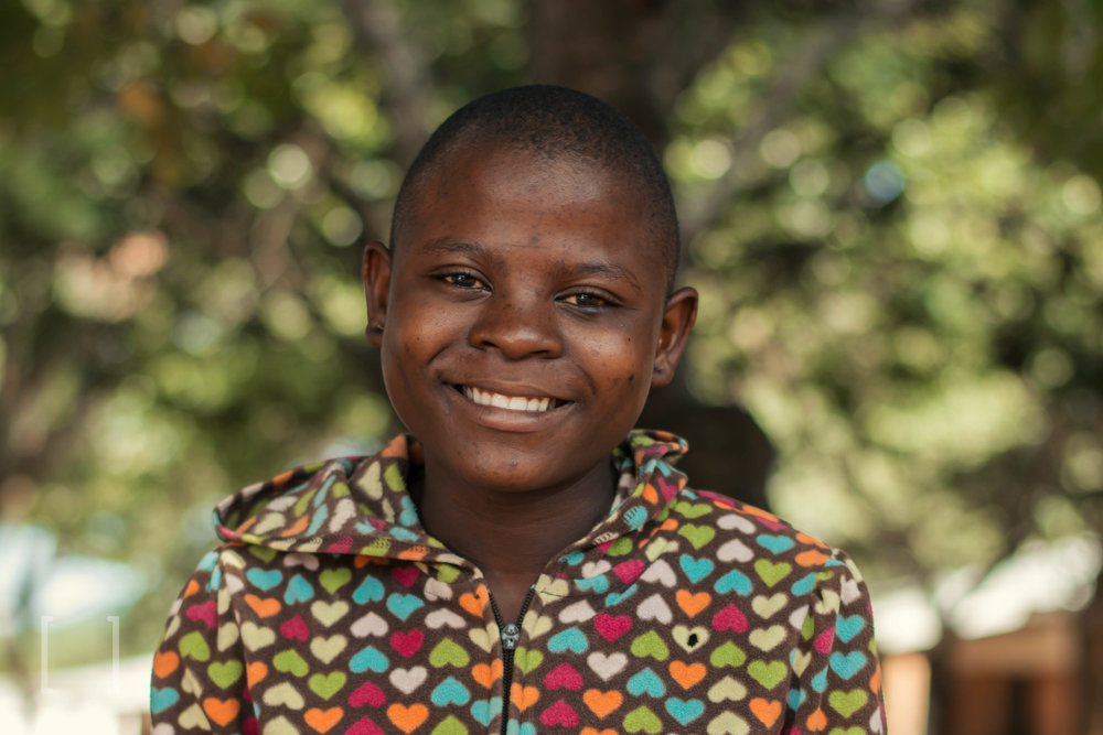 Eferina  - After the death of her mother, Eferina's father refused to take her in and told the authorities that they were unrelated. She now stays at Home of Hope. She is so cheerful and likes playing lots with friends. Be a part of her global family!