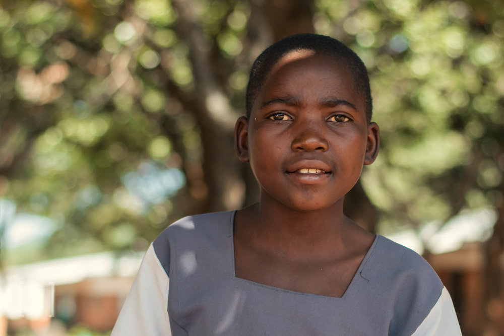 Brenda  - Brenda does well in school and likes playing netball in her free time. She would like to become a nurse when she finishes her education. Support her dreams!