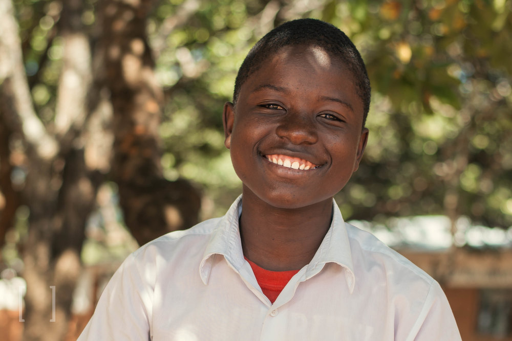 Comfort  - Comfort was born in 2003 but his exact birthday is unknown since both of his parents have passed away. He came to Home of Hope at 13 years old and is doing well in high school. He wishes to become a teacher when he is older. Give Comfort some comfort and become his sponsor!