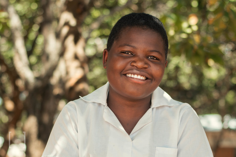 Efrida  - Efrida is smart and does well in class. She is glad Home of Hope gives her access to a quality education. She likes playing girls' soccer in her free time, and wishes to become a nurse. Sponsor her today!