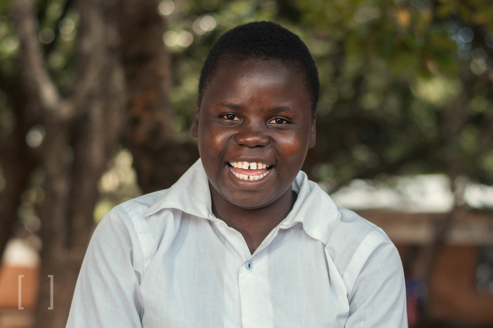 Martha  - Martha has 6 siblings but she is the only one interested in pursuing her education. Her favorite colour is blue and she likes playing girls' soccer during her free time. She does well in class and wants to become a teacher. Extend her a helping hand!