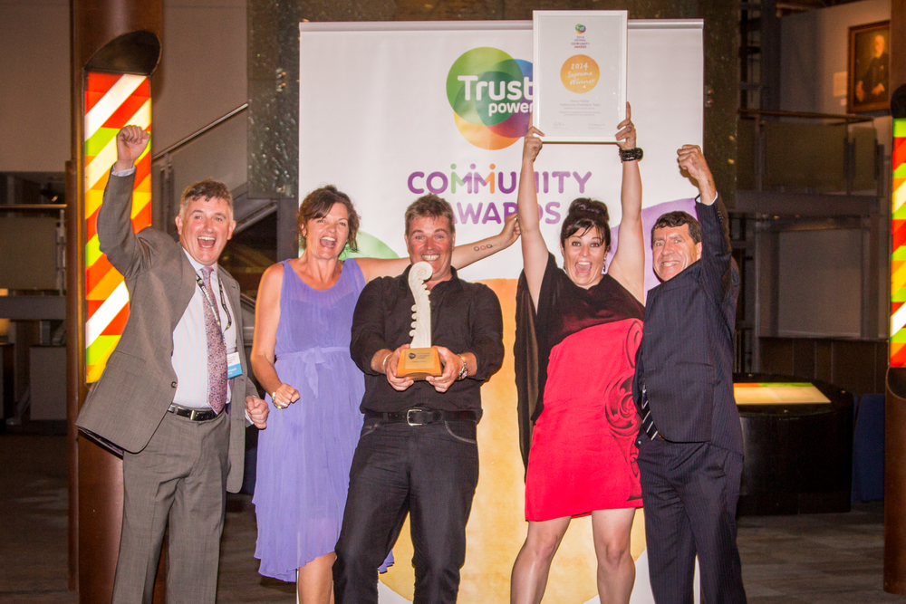 Celebrating the Truspower Award with Focus Paihia Trustees and Trustpower representatives.