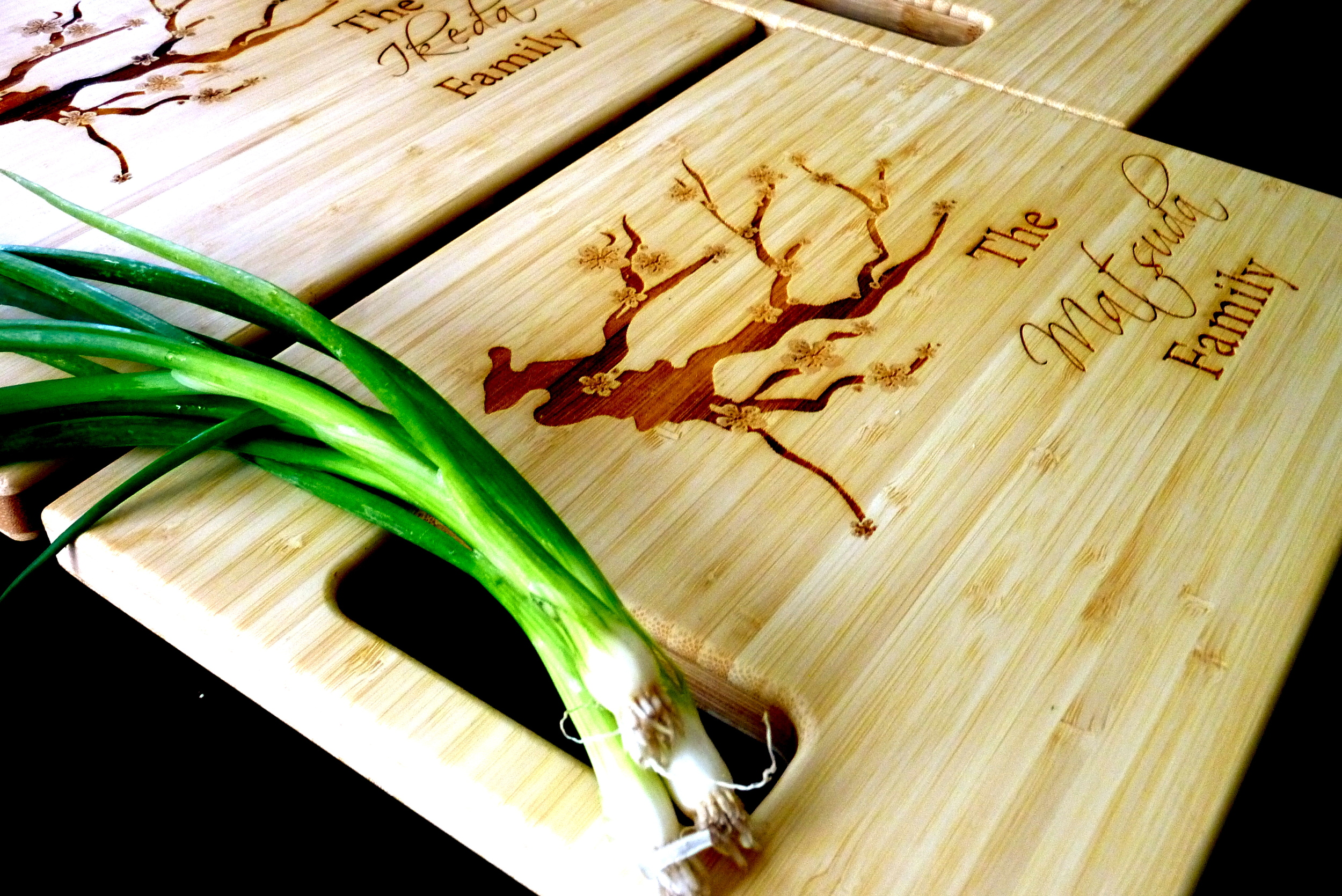 A Cherry Blossom design done on a bamboo cutting board.