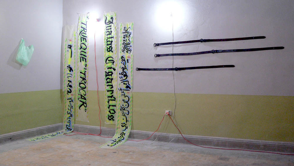 Jualas Cigarillios,Acrylic on wax paper, plastic bag with inflated baloon fluorescent lighting fixtures and extension cords, Stamped leather belts, 2007