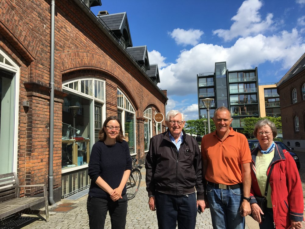 From Left: producer Signe Byrge Sørensen welcomes Jørgen Aage Holm, his son and family to the Copenhagen office.