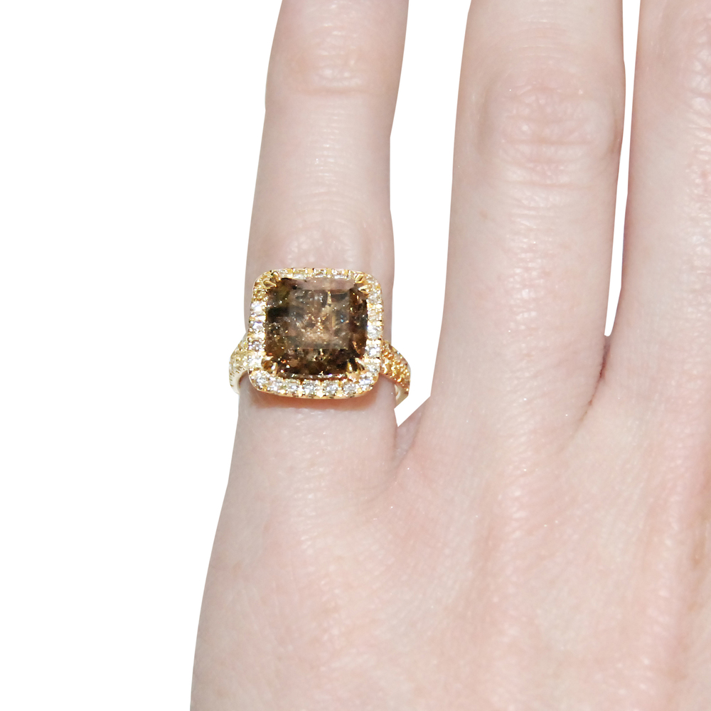 Cushion-shaped-diamond-cut-down-cluster-ring-finger shot.jpg