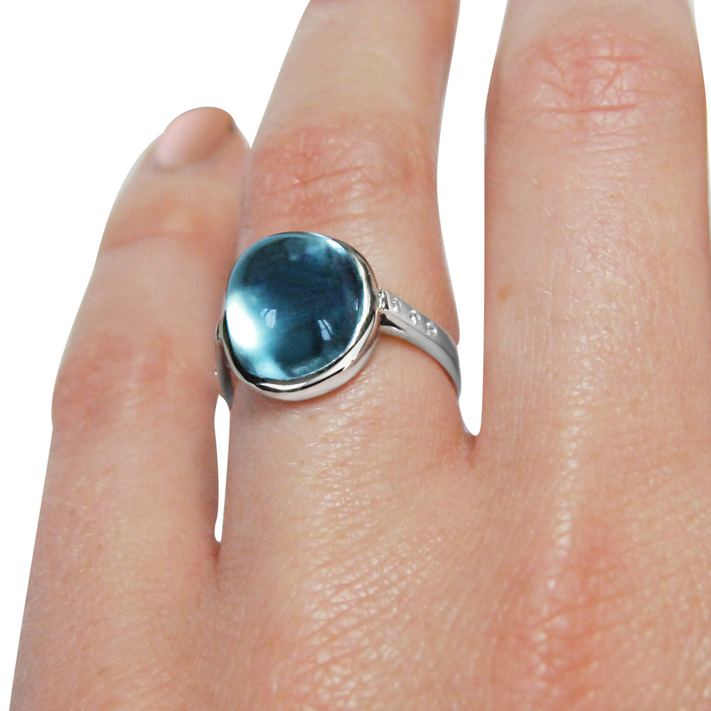 Cabochon-aquamarine-and-18ct-white-gold-ring-finger-shot.jpg