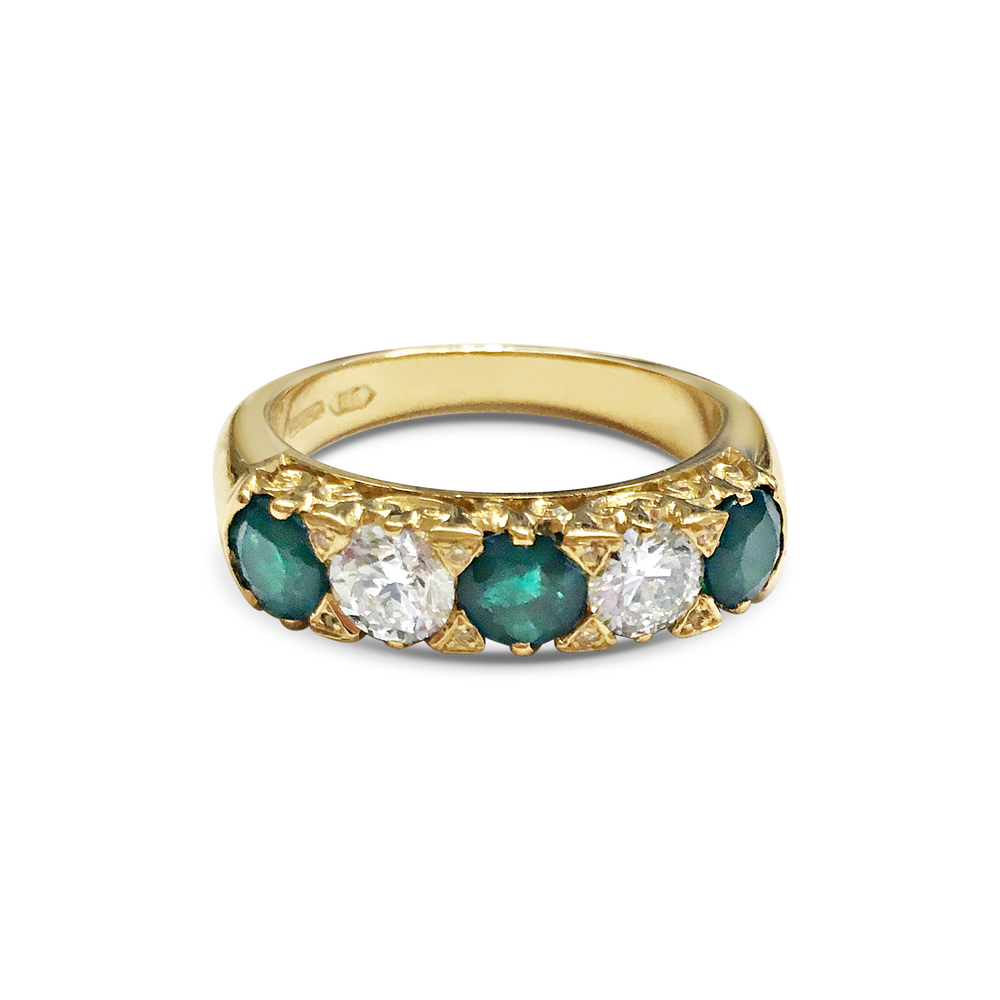 Emerald-and-diamond-carved-half-hoop-ring-1.jpg