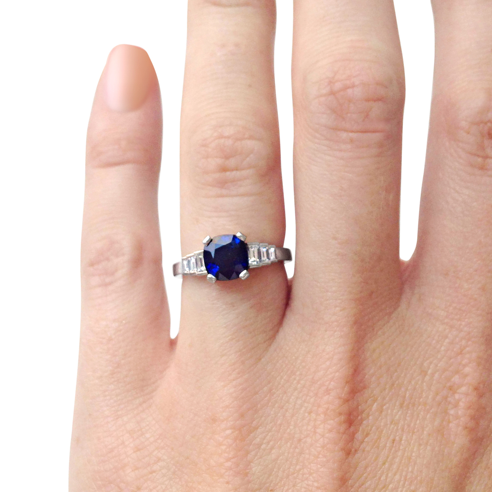 cushion-shaped-Sapphire-and-diamond-baguette-cut-ring-mounted-in-platinum-1.jpg