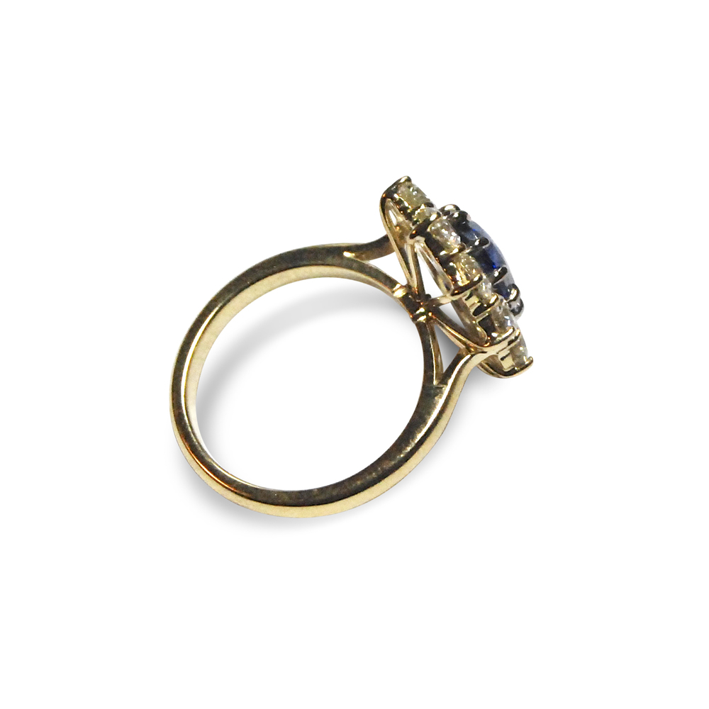 Sapphire-and-diamond-cluster-ring-mounted-in-yellow-gold-1.jpg