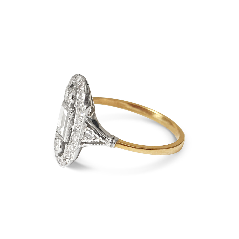 antique-style baguette and brilliant-cut diamond panel ring side