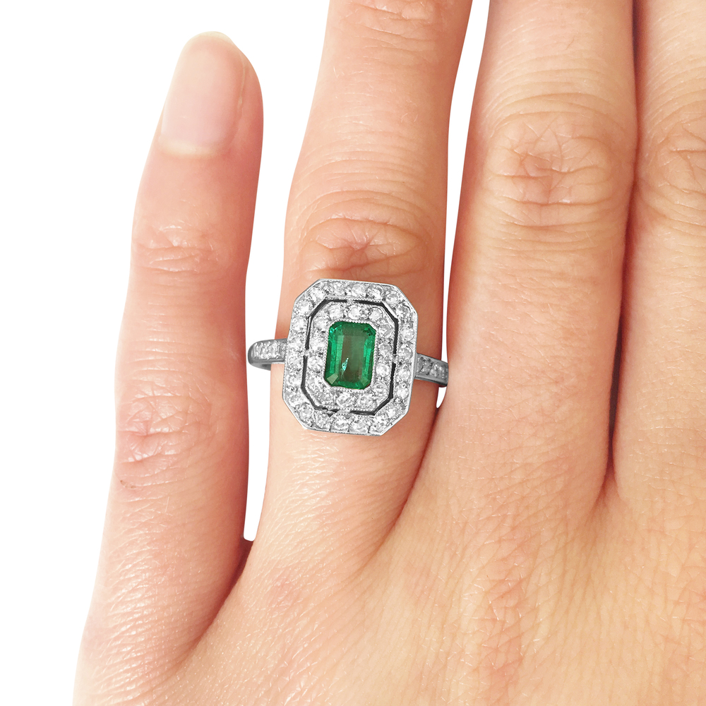 emerald and diamond two-row ring hand shot