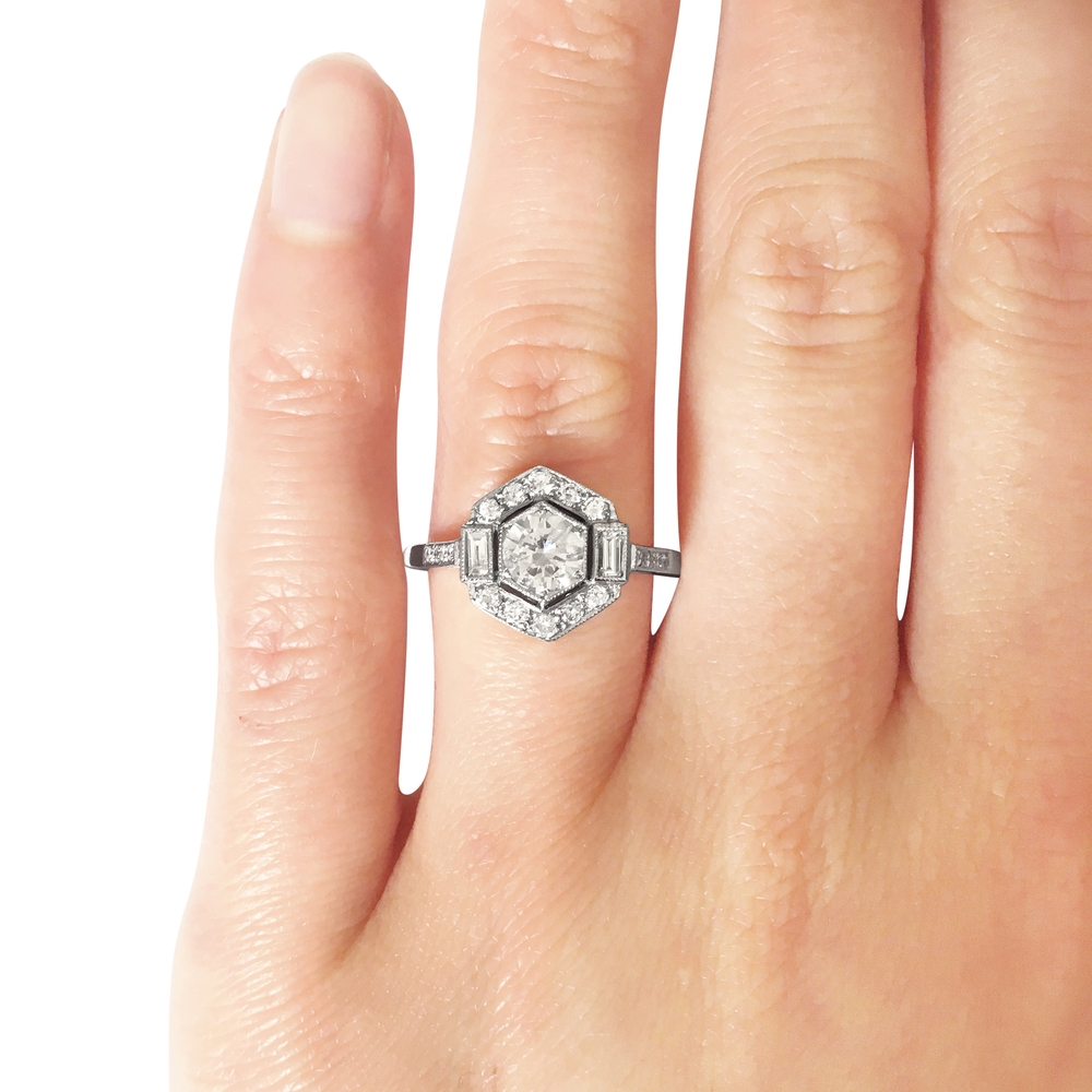 antique style hexagonal brilliant and baguette-cut diamond single row cluster ring hand shot