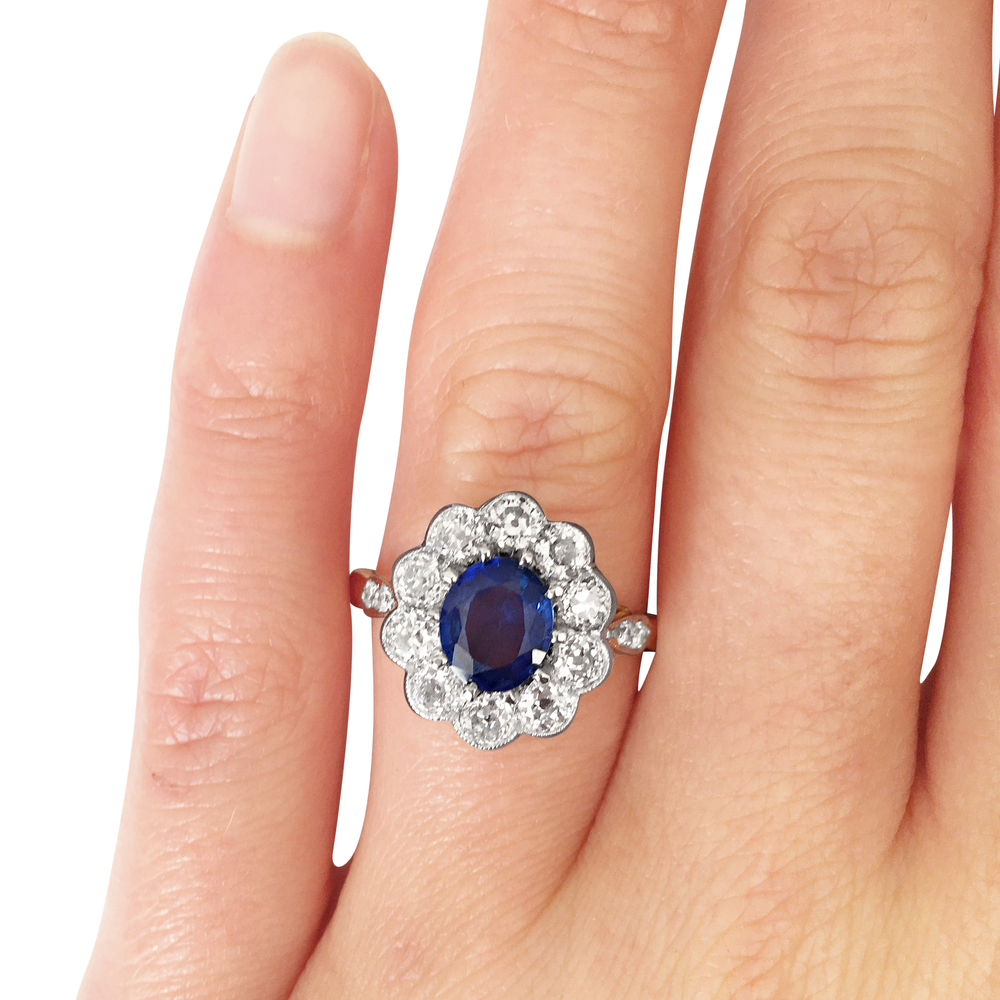 sapphire & diamond oval cluster ring hand shot