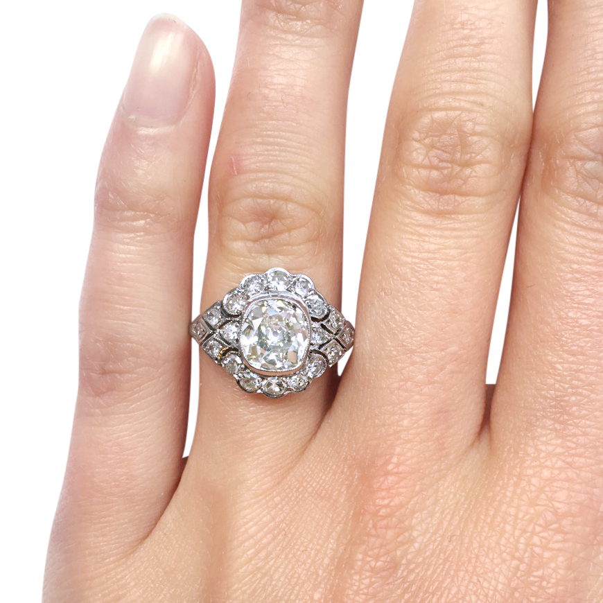 cushion-cut diamond ring hand shot