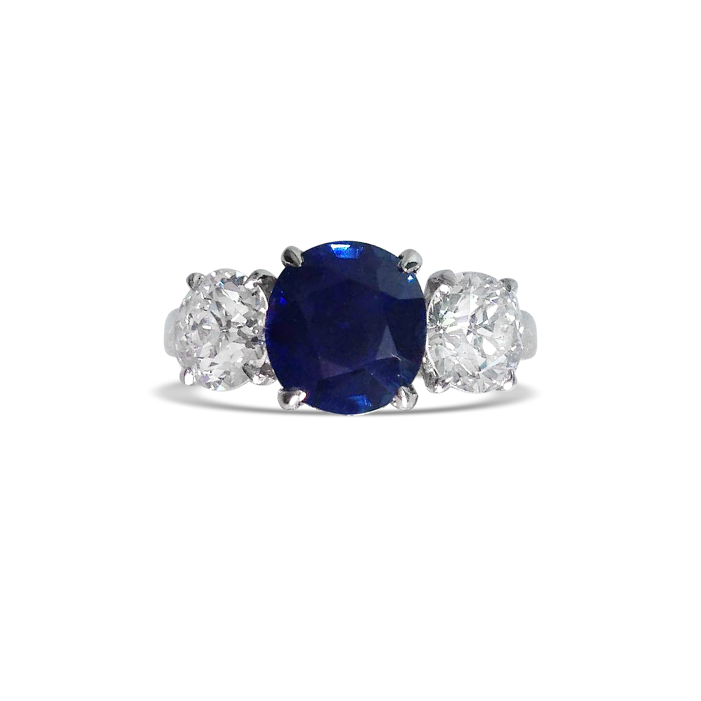 sapphire-and-diamond-three-stone-ring-mounted-in-platinum.jpg
