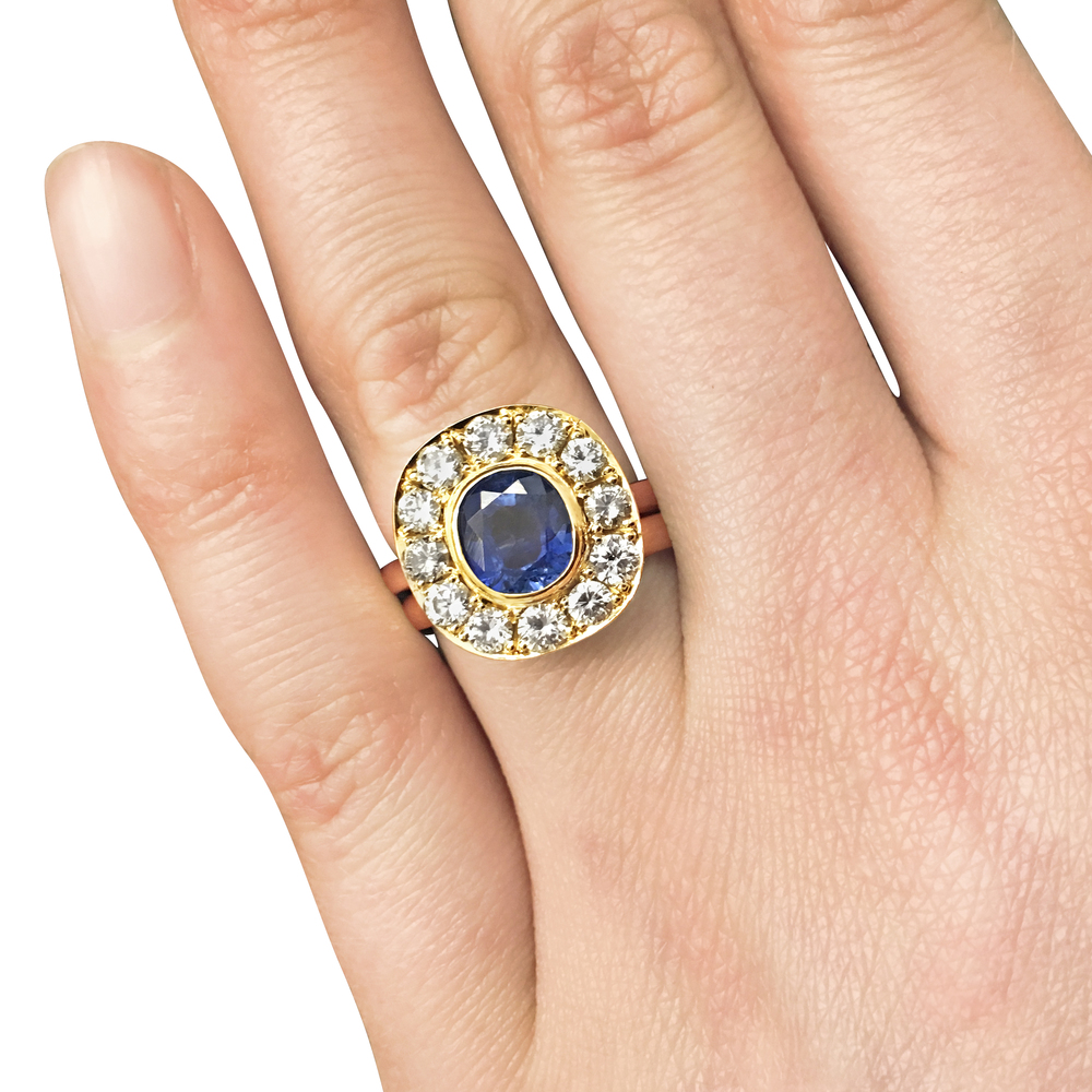 Sapphire-and-diamond-cluster-engagement-ring-in-yellow-gold-4.jpg