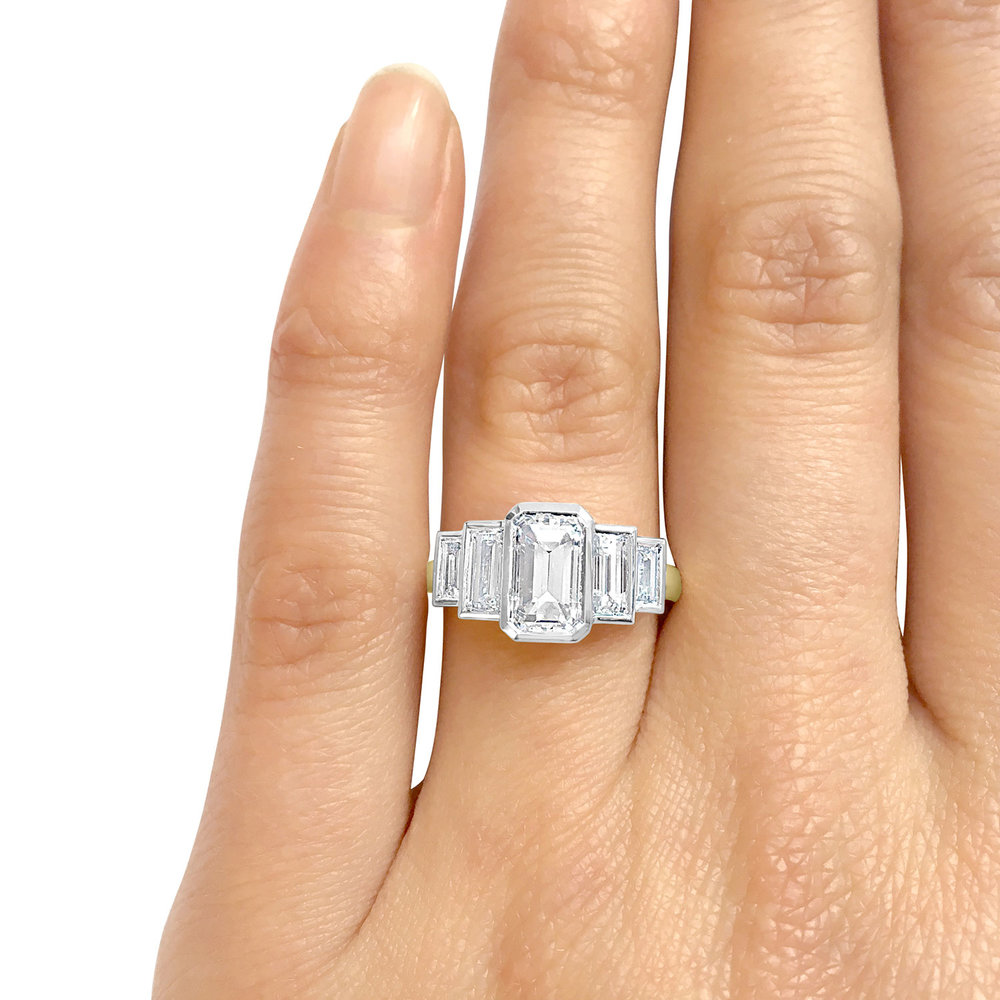 Bespoke emerald-cut diamond five-stone ring, hand shot