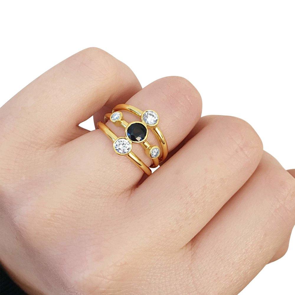 Bespoke sapphire and diamond rub over set five stone ring hand shot