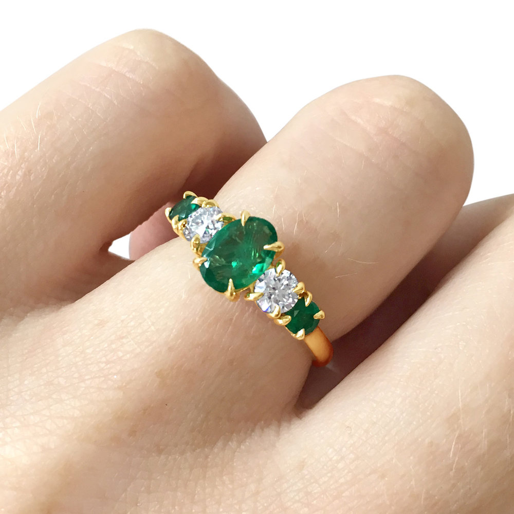 Bespoke emerald and diamond claw-set five-stone ring, mounted in 18ct yellow gold side