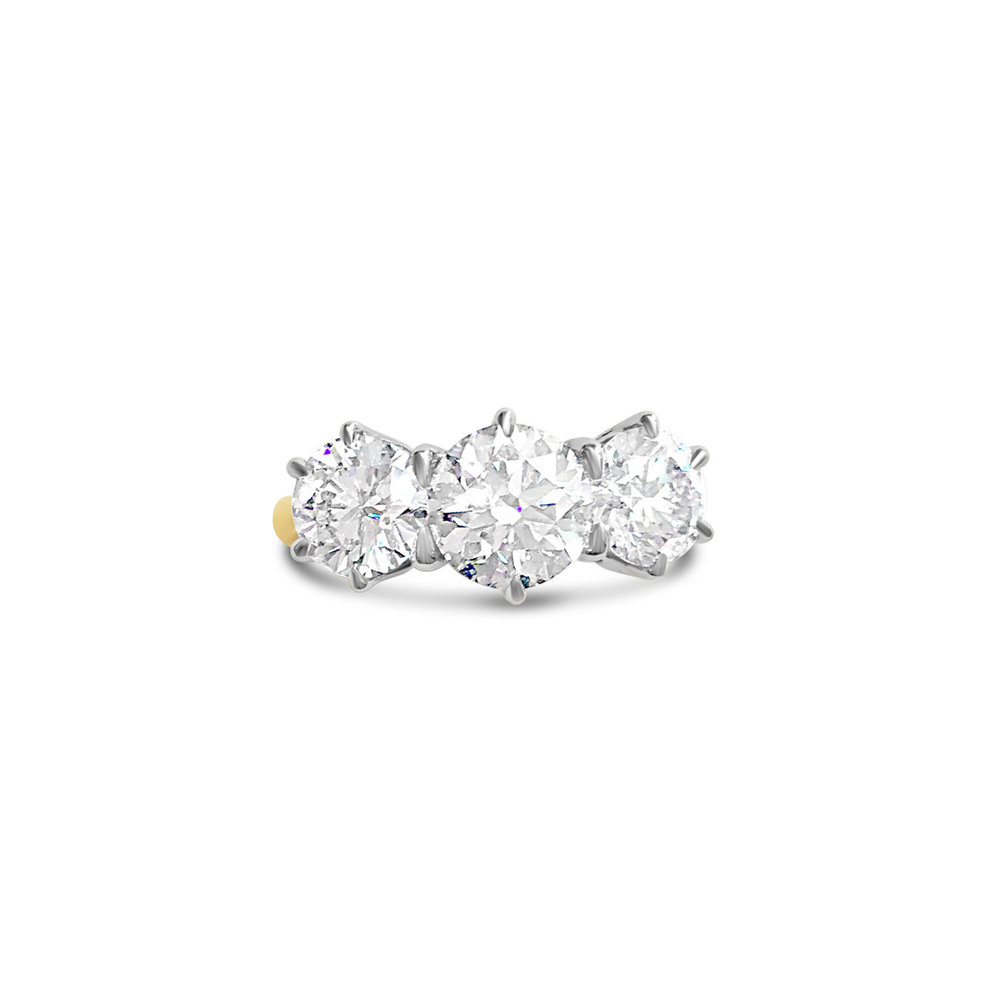 Brilliant-cut diamond three-stone claw-set ring in 18ct white and yellow gold top