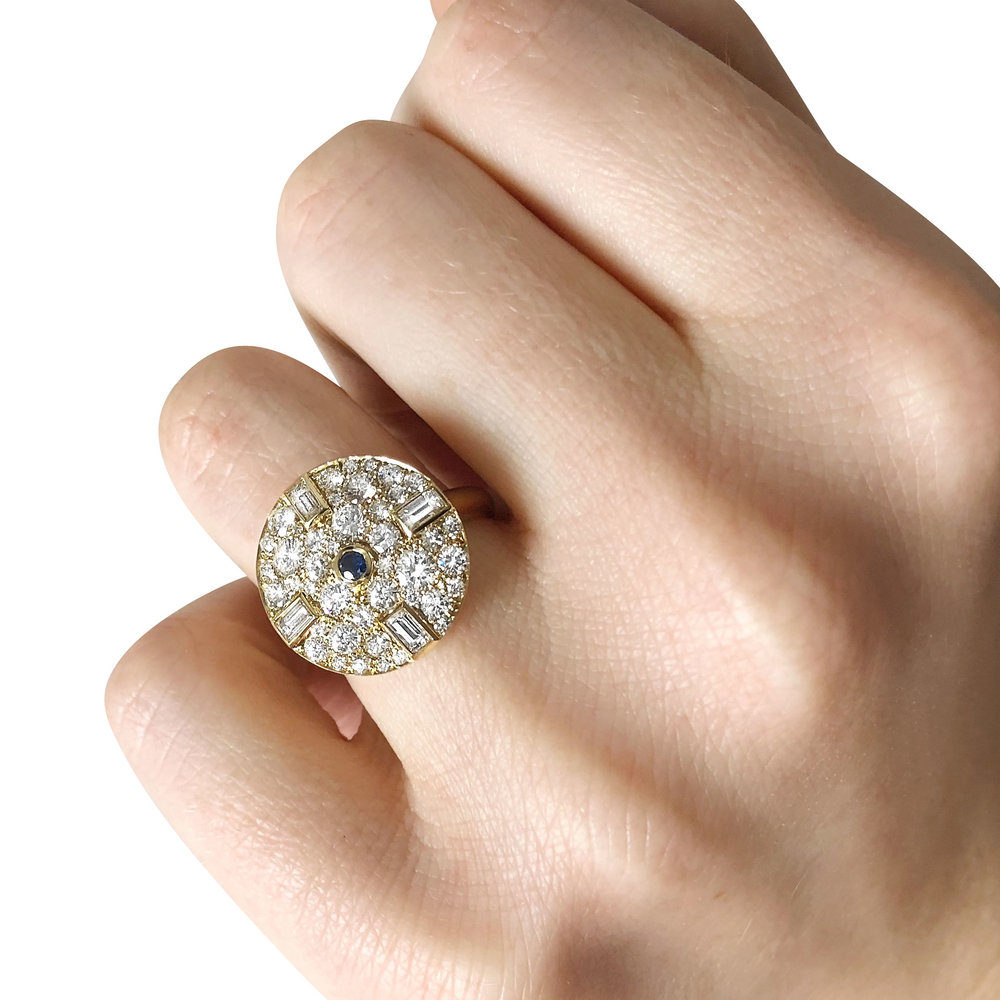 Bespoke sapphire, baguette-cut diamond and pavé-set diamond circular ring, mounted in 18ct yellow gold hand