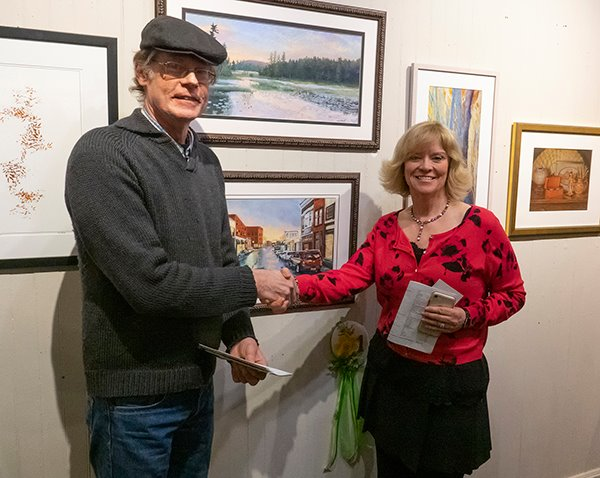 Mark Kurtz presents Susan Whiteman with the first place award at the Adirondack Artists Guild's annual juried show. (Photo- Barry Lobdell)