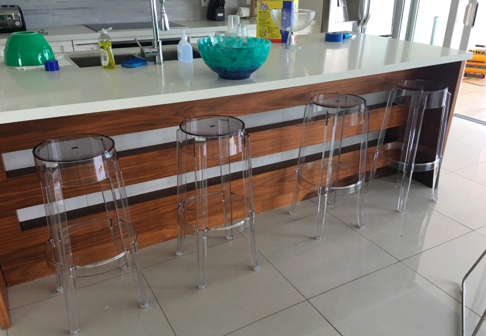 The bottom of the old barstools took some rust damage, so here's to Kartell plastic.