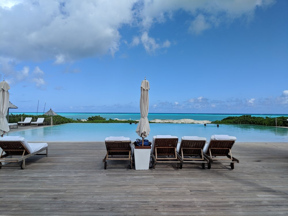 The ginormous pool overlooks the turquoise waters!