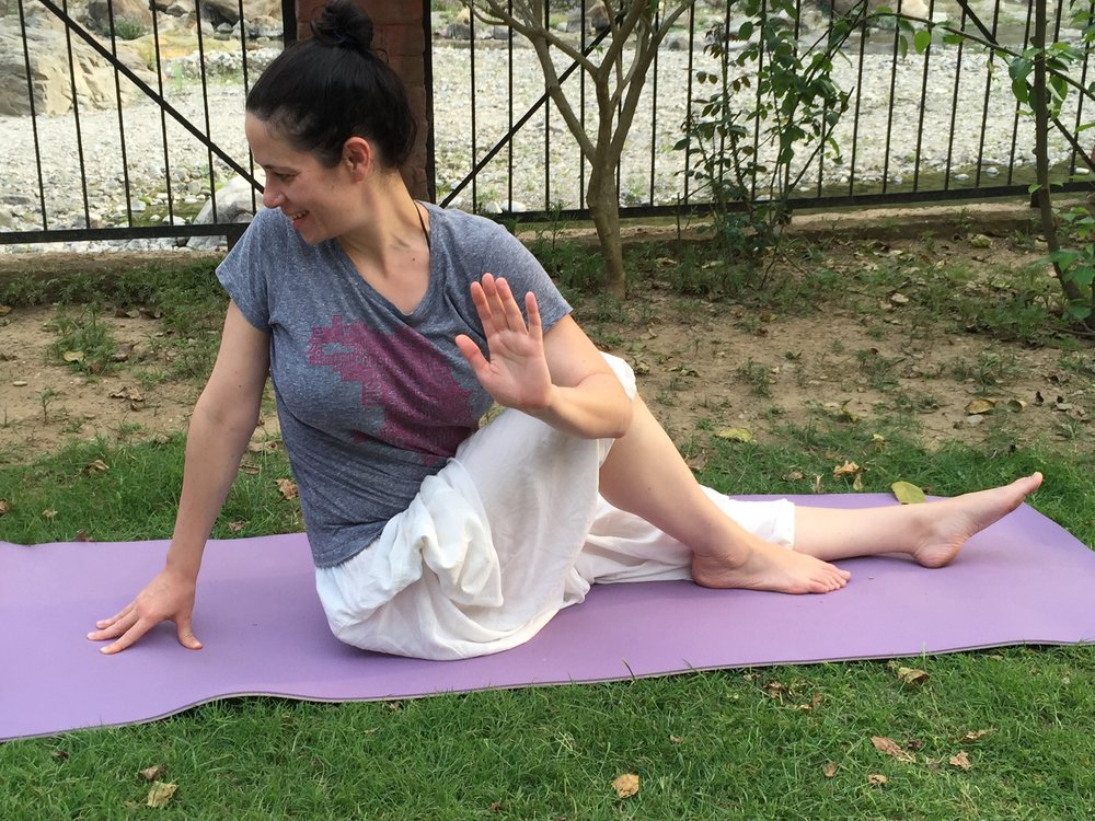 At teacher training in India, doing a spinal twist yoga asana (not talking to the hand)