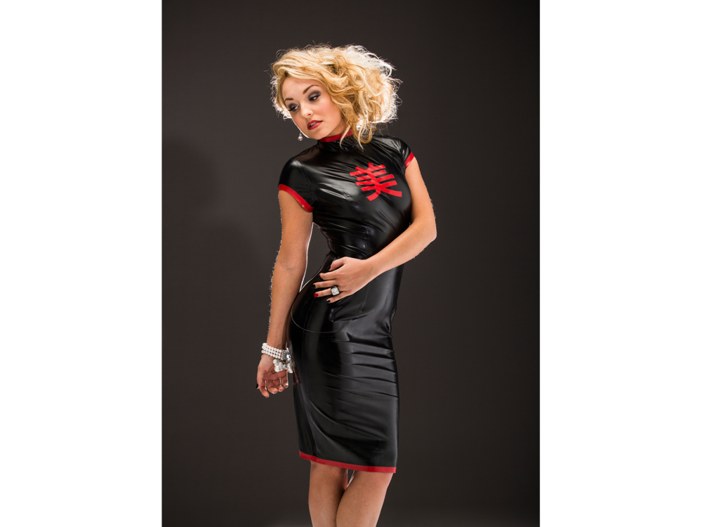 Blonde woman in black and red latex dress for fashion and hair shoot