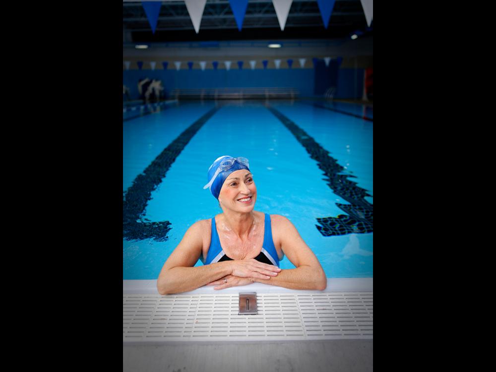 Senior living advertisement of woman in lap lane of swimming pool
