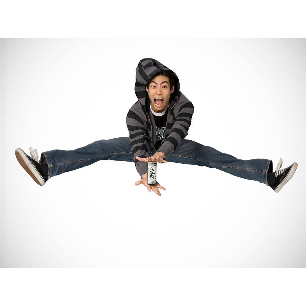 Boy in hoodie jumping splits for energy drink advertisement