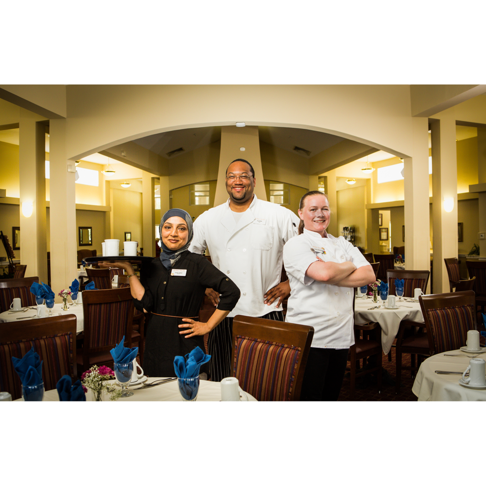 Portrait of restaurant server and chefs