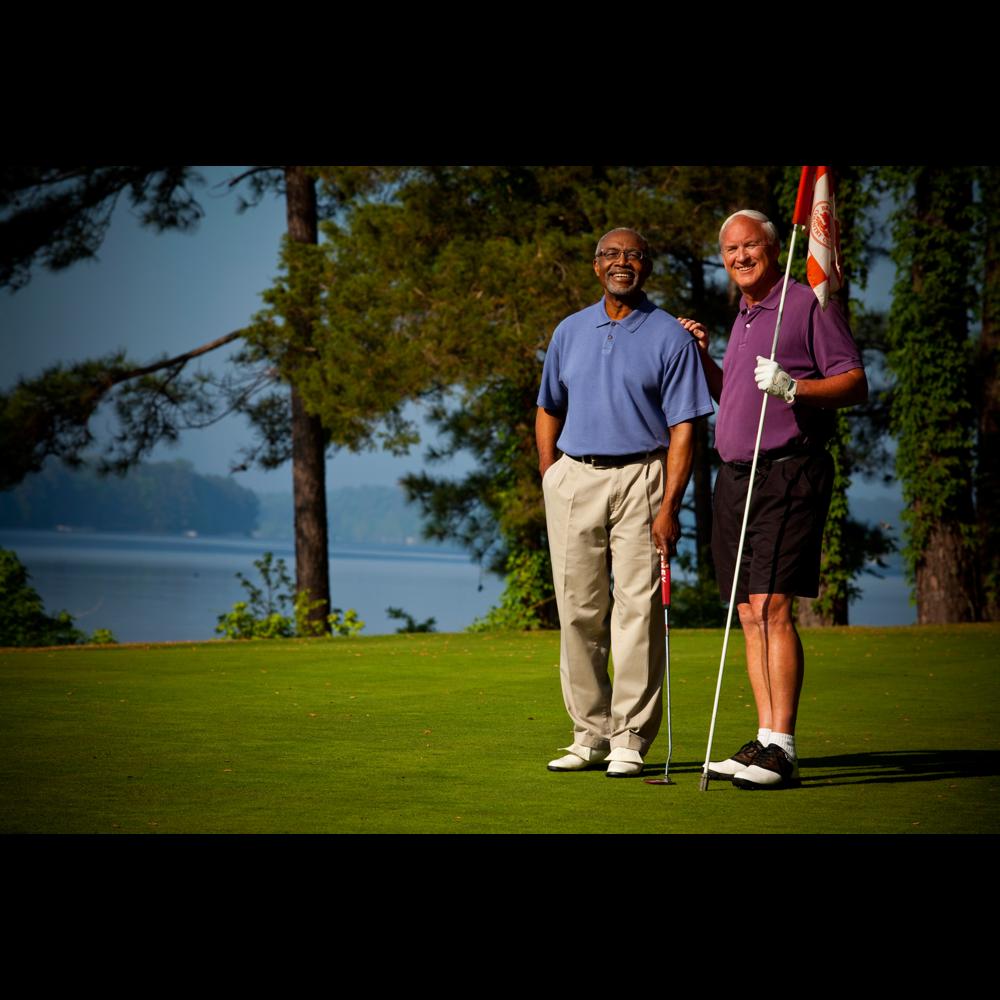 Photo of retired gentlemen on golf course green