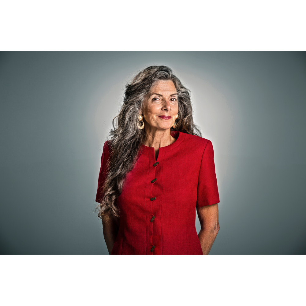 Portrait of senior woman in red dress for trade show booth display