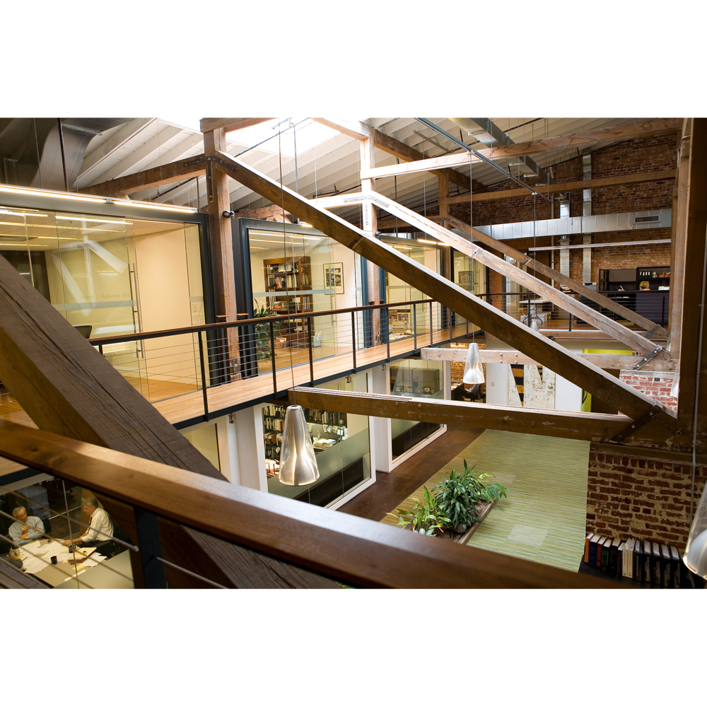 Interior photograph of modern office with beams glass and brick for architectural website