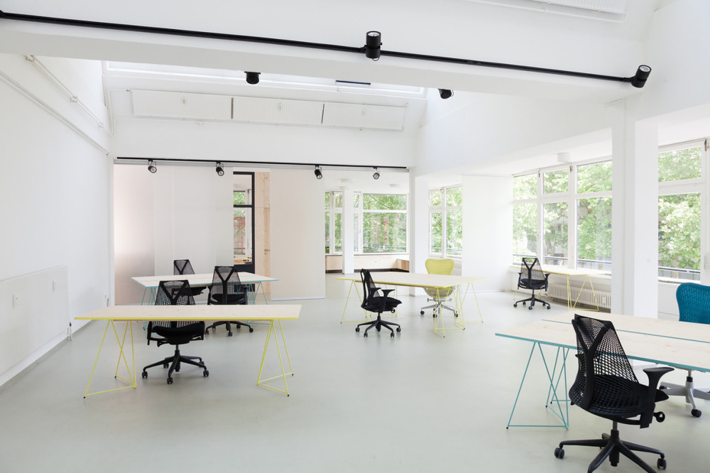 Impact Hub Berlin is a minimalist work space located in Berlin, Germany, designed by Leroux Sichrovsky Architects.