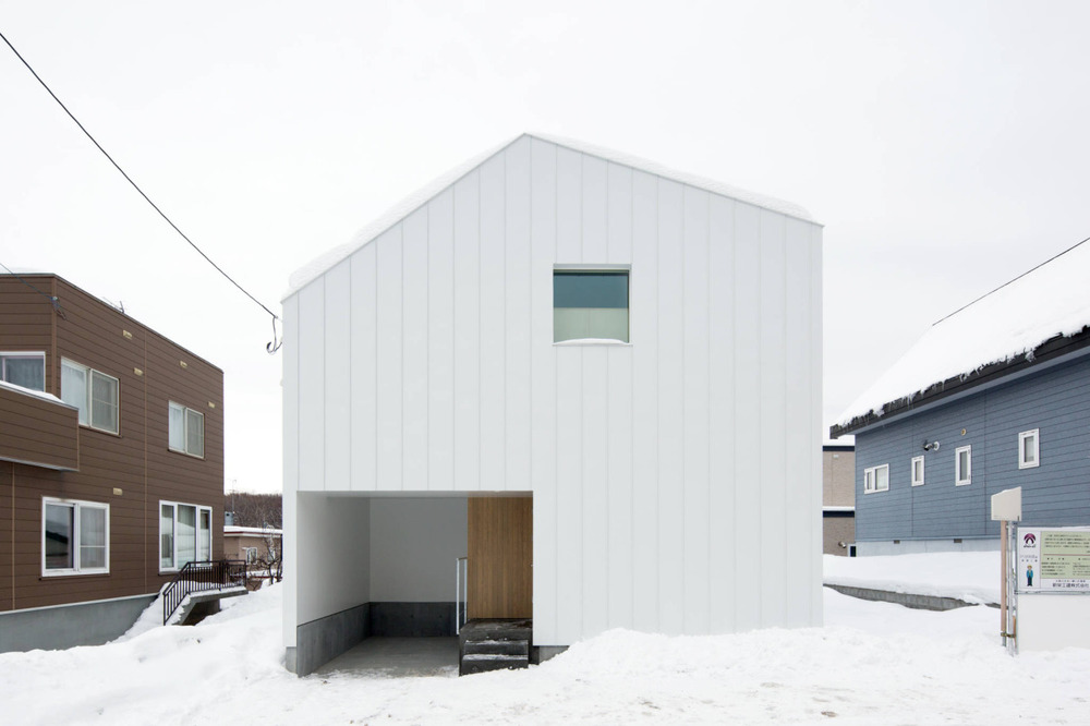Slide is a minimalist house in Sapporo, Japan.