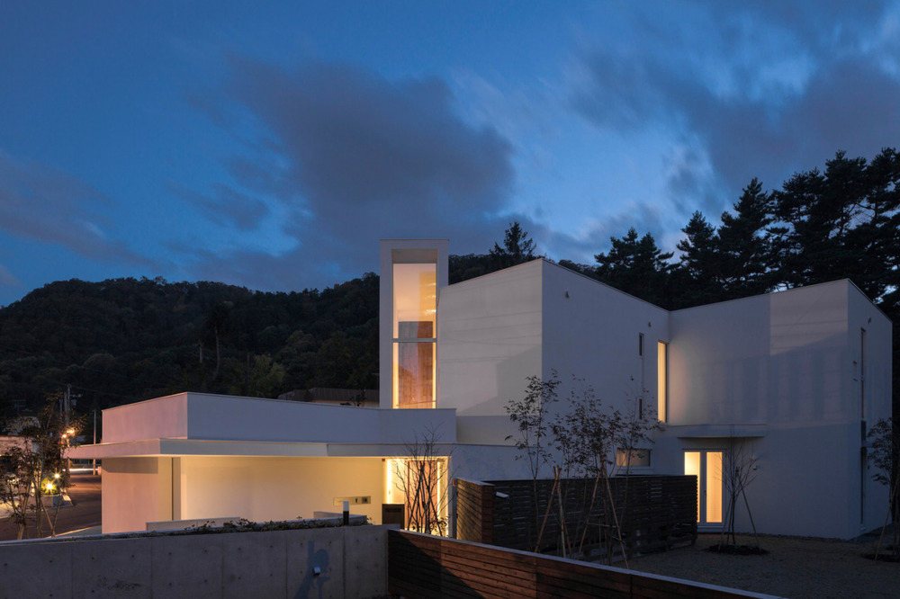 Double Angle House is a minimalist river house designed by Japan-based architects.