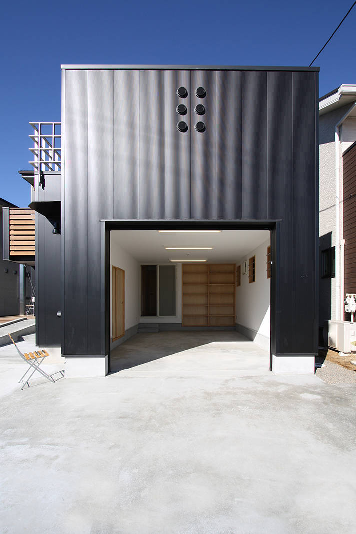 Two-Family House with Wooden Deck  is a minimalist home in Saitama, Japan.