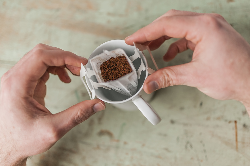 3. Secure the filter legs on your favorite coffee cup