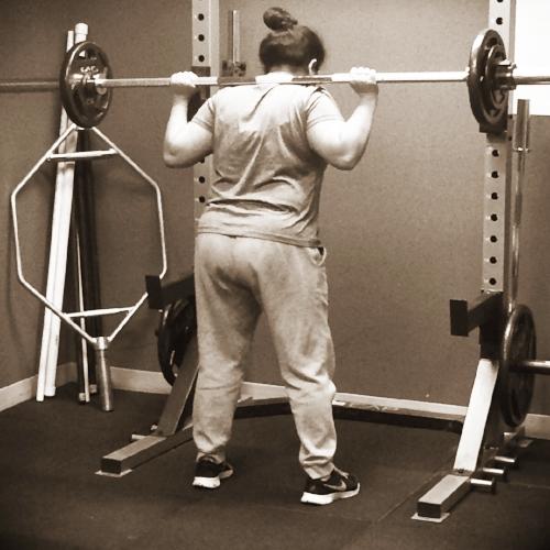 strength essentials 716 woman squatting