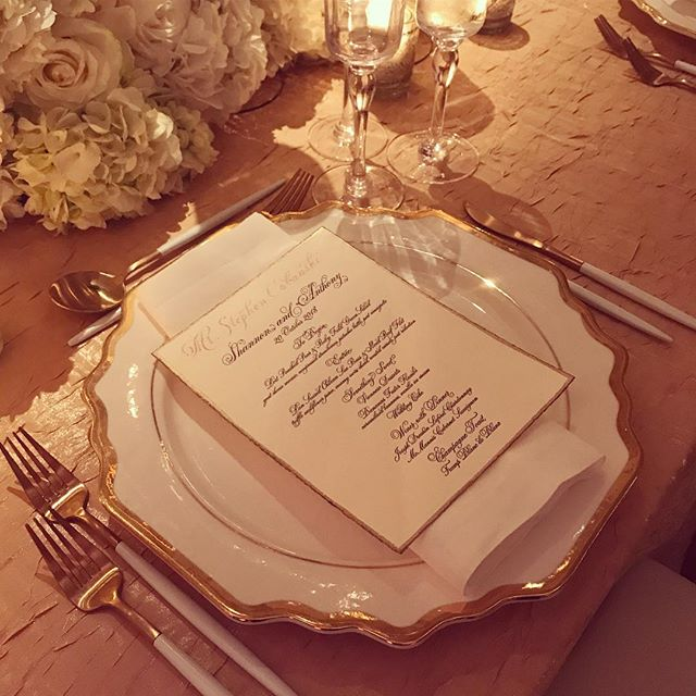 Breathtaking all around. Beautiful flowers, beautiful lighting, beautiful details...deckled letterpress menus with gorgeous calligraphy and hand painted edges. Not nearly as stunning as the beautiful couple but one of many elements that helped bring together the gorgeous day.