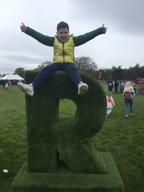 My 10 year old nephew Rohan enjoying sitting on his larger than life initial