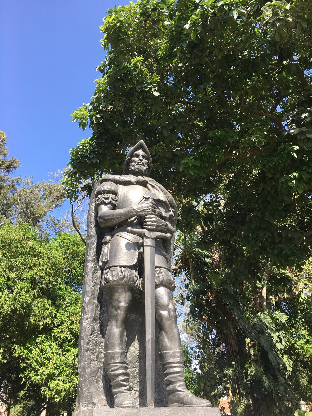 A statue of Juan Vazquez de Coronado overlooks a fountain in Parque Espana. The Spanish conquistador played a major role in the colonization of Costa Rica and was the province's first appointed Royal Governor.