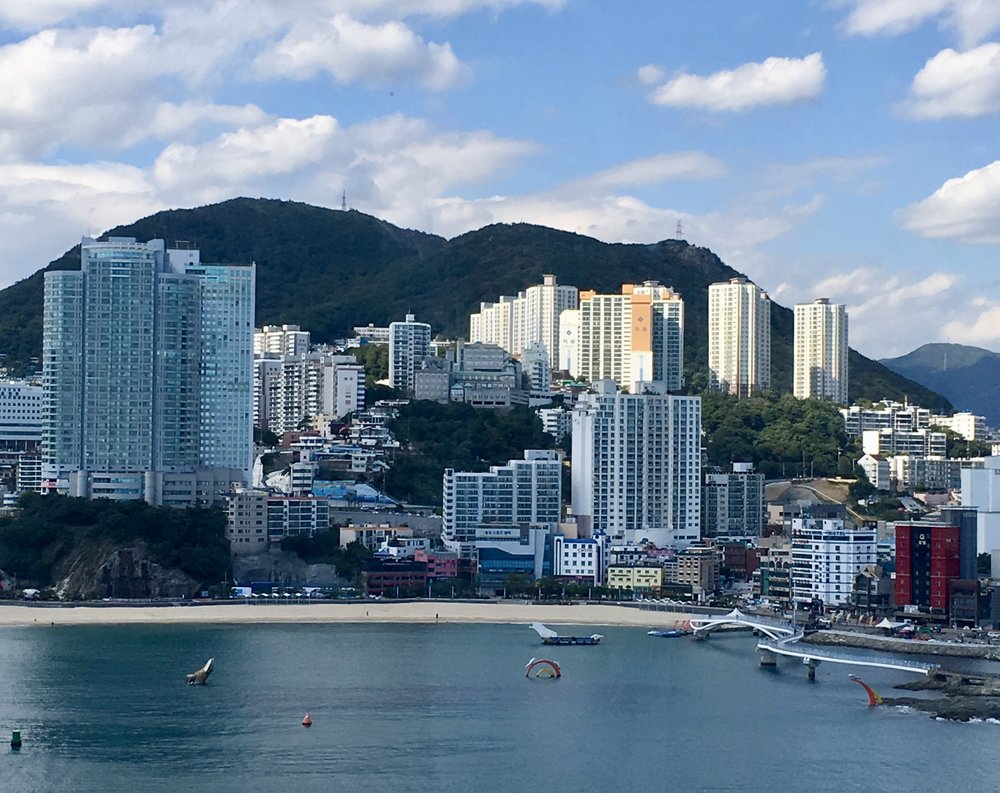 Busan is a thriving metropolis situated between beautiful mountains and picturesque beaches.