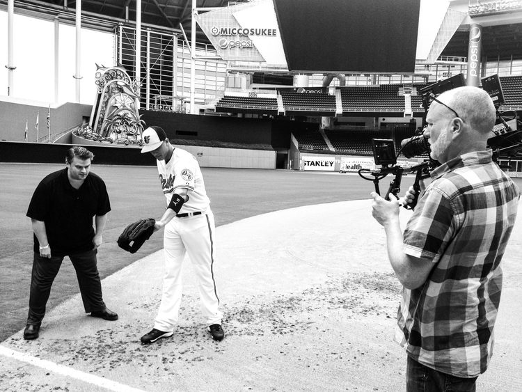 Peter+Cumbo+and+Chris+Santucci+on+location+with+Manny+Machado+of+the+Baltimore+Orioles.jpg
