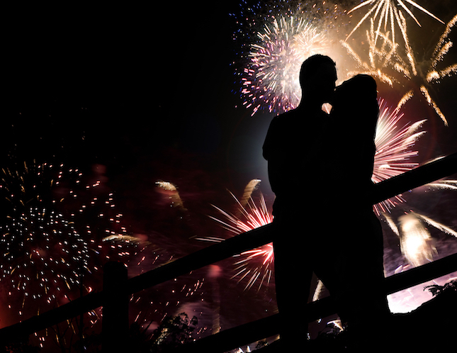 a-silhouette-of-a-kissing-couple-in-front-of-a-huge-fireworks-display_St7-4ydRBj.jpg
